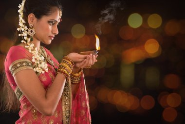 Indian girl hands holding diwali lights