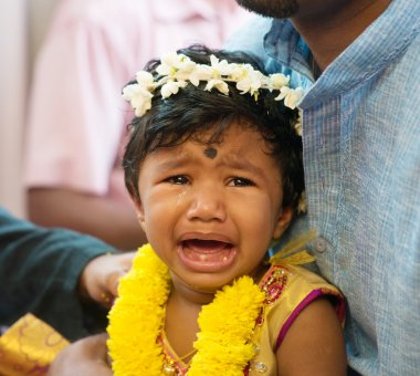 Baby girl crying after karna vedha events. Traditional Indian Hindus ear piercing ceremony. India special rituals. stock vector