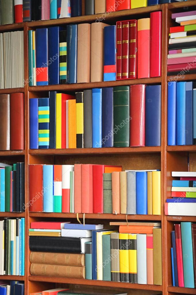 Books At Bookshelf In Library Stock Photo