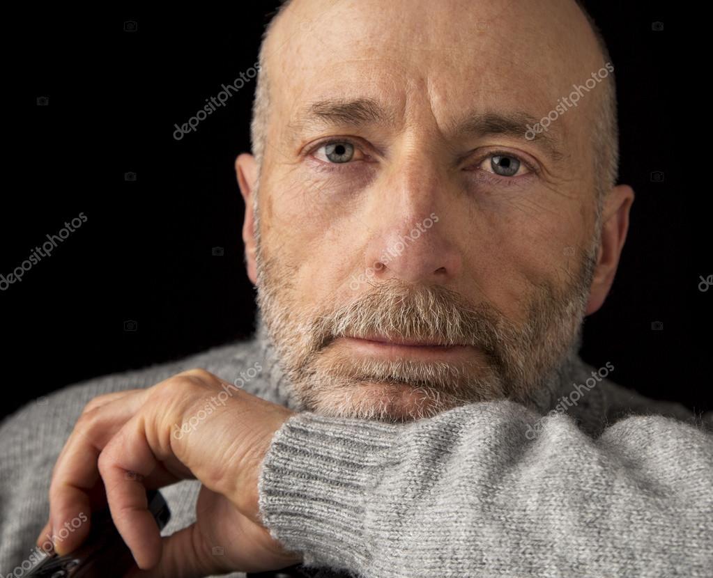 headshot of confident eleder man