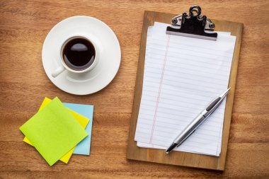 Desktop concept - clipboard with blank paper and pen, sticky notes and coffee stock vector