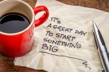 It is a great day to start something big - motivational handwriting on a napkin with a cup of coffee stock vector