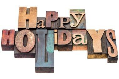 Happy Holidays greetings in wood type