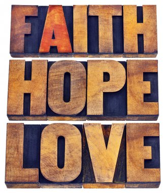 Faith, hope and love - a collage of isolated words in vintage letterpress wood type stained by color inks stock vector