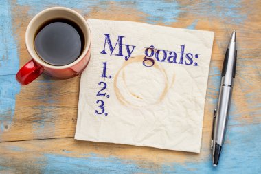 my goals list on napkin and coffee