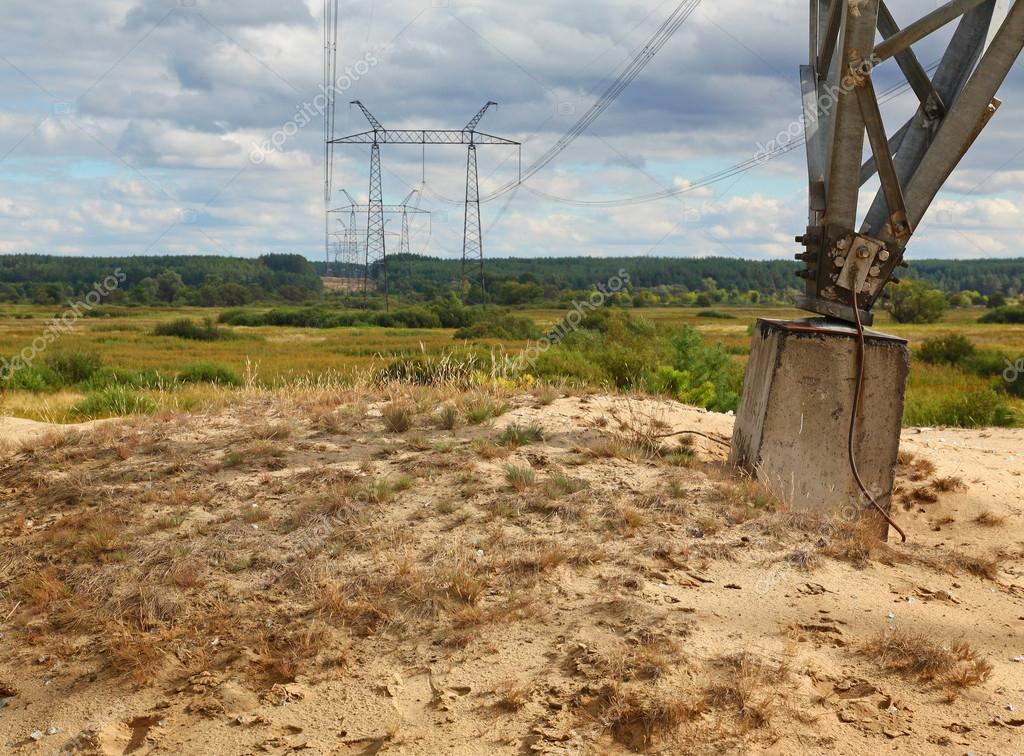 Transmission tower through valley