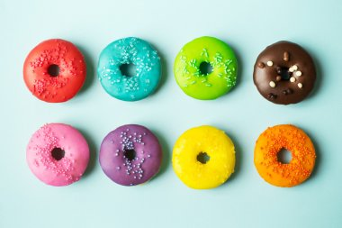Colorful donuts on a blue background stock vector