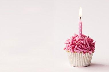 Birthday cupcake on pink
