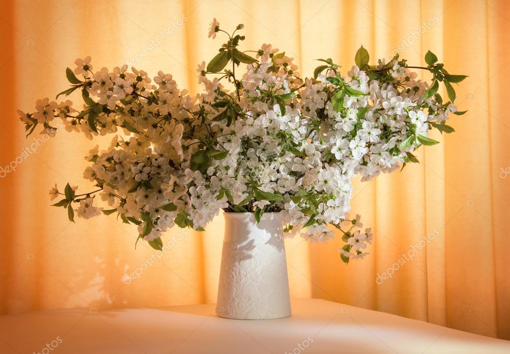 Bunch of flowering branches in vase