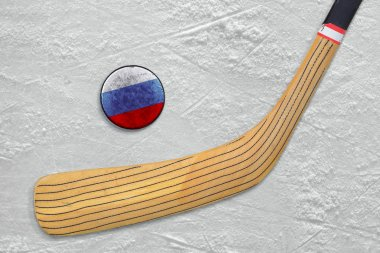 Hockey stick and puck on the Russian hockey rink