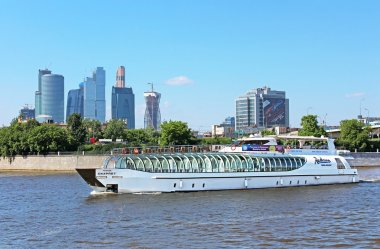 View of Moscow river, pleasure boat and Moscow International Business Center (Moscow City), Russia