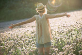 Photo Enjoyment - free happy woman enjoying sunset. Beautiful woman embracing the golden sunshine glow of sunset with arms outspread enjoying peace, serenity in nature