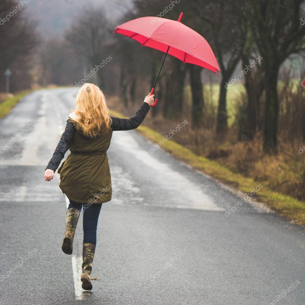 ac76a6228f000 Woman with umbrella — Stock Photo © loriklaszlo #53963489