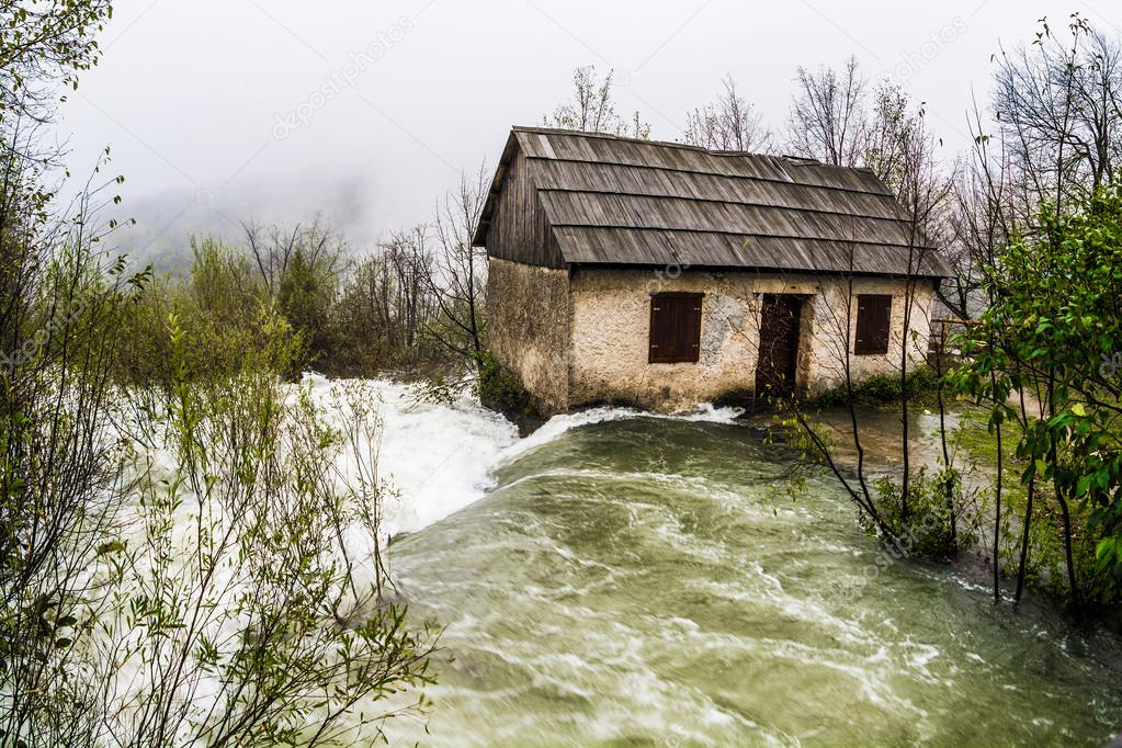 Flood, abandoned house washed away