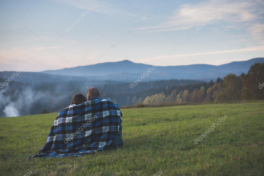 Couple watching landscape and mountains