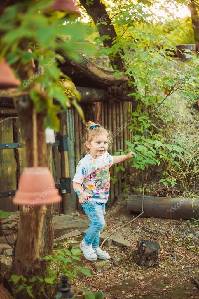 Girl near tiny house