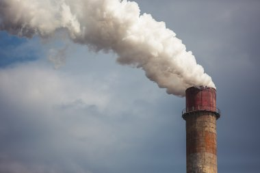 Smoke rising from an industrial chimney