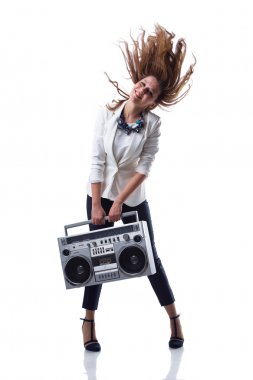 Attractive young cool hip hop dancer with boom box