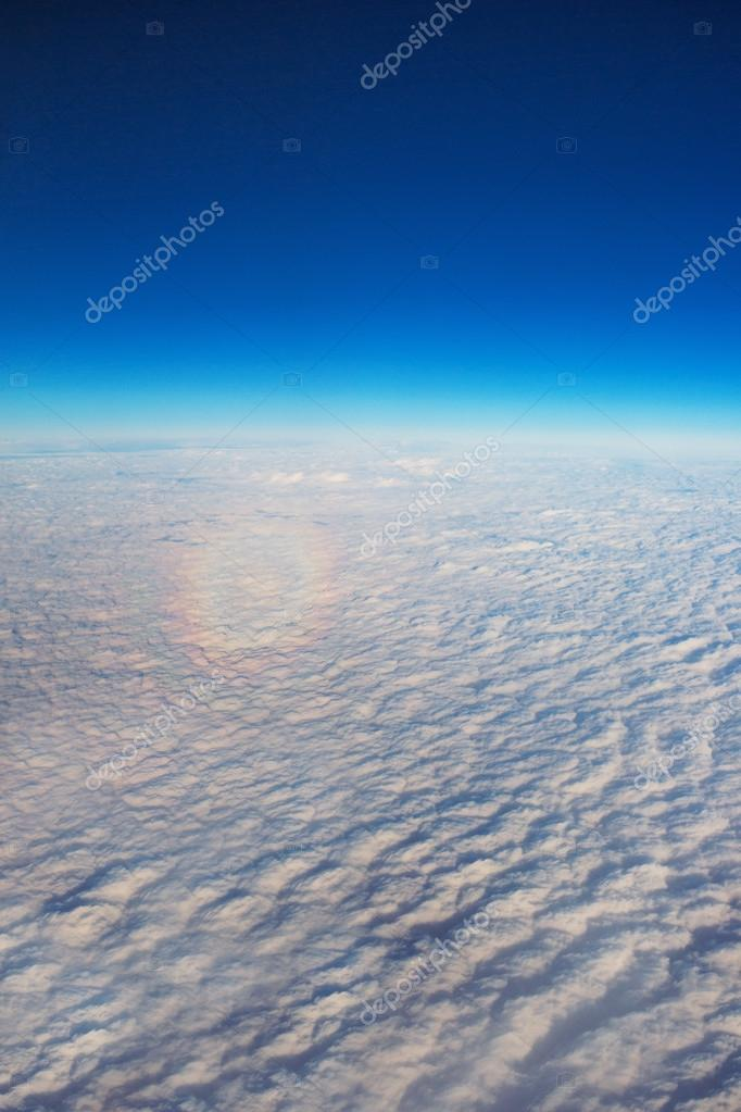 Rainbow from the top, view from the airplane