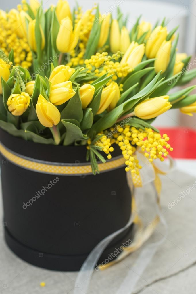 Bright Spring Bouquet Of Tulips And Mimosa Flowers Stock Photo