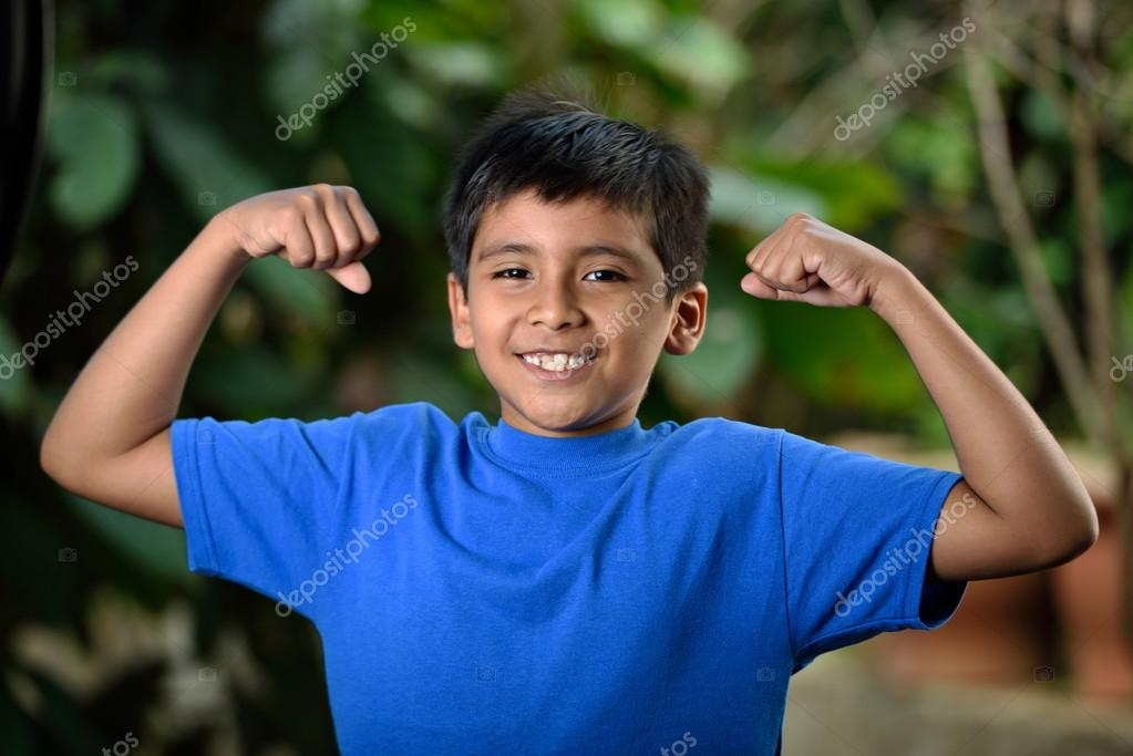 Latino boy shows what he has