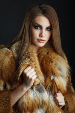 Beauty Fashion Model Girl in  fox Fur Coat.