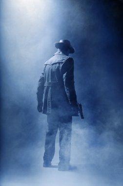 Faceless killer in the haze.