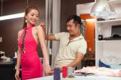asian tailor with female customer