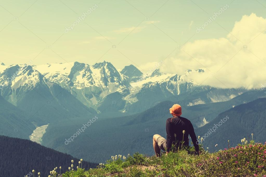 Backpacker resting in mountains