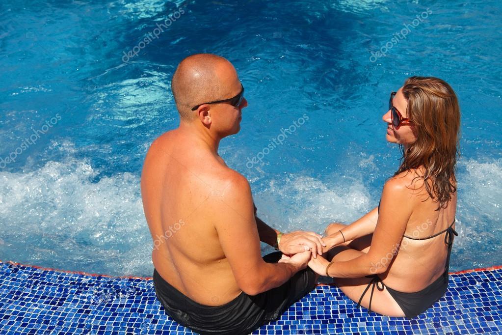 Romantic couple relaxing near pool