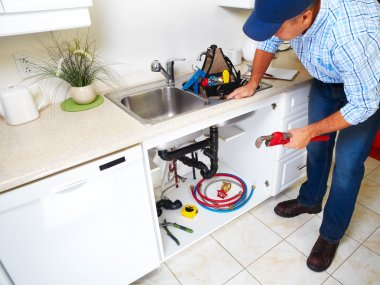 Plumber on the kitchen.