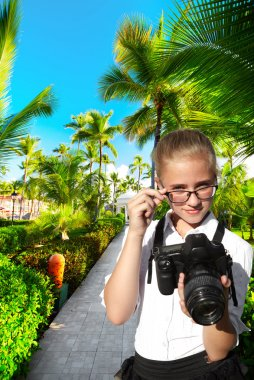 Young photographer and tropical resort