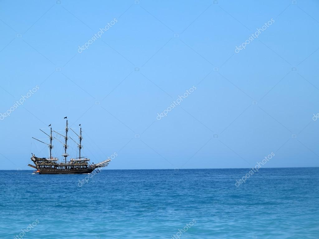 Old wooden old ship in blue sea