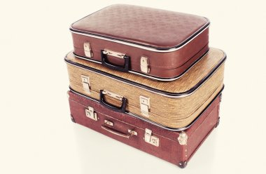 old vintage suitcases on white background