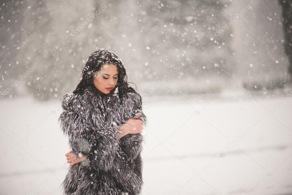 Winter portrait of Beauty girl with snow