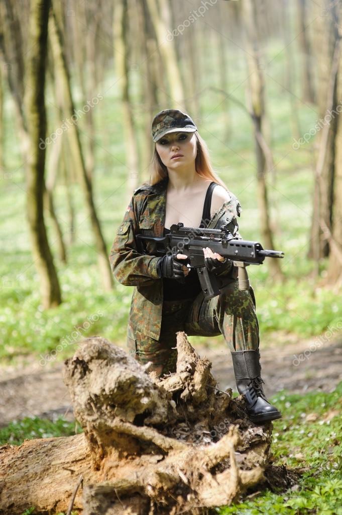 Beautiful army girl with gun