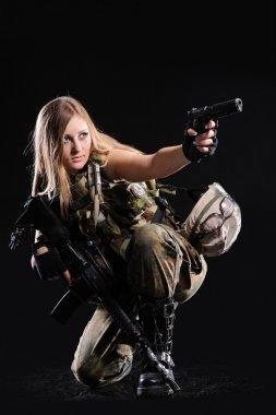 Beautiful army girl with gun