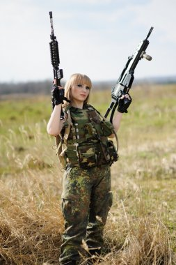 Beautiful army girl  with guns