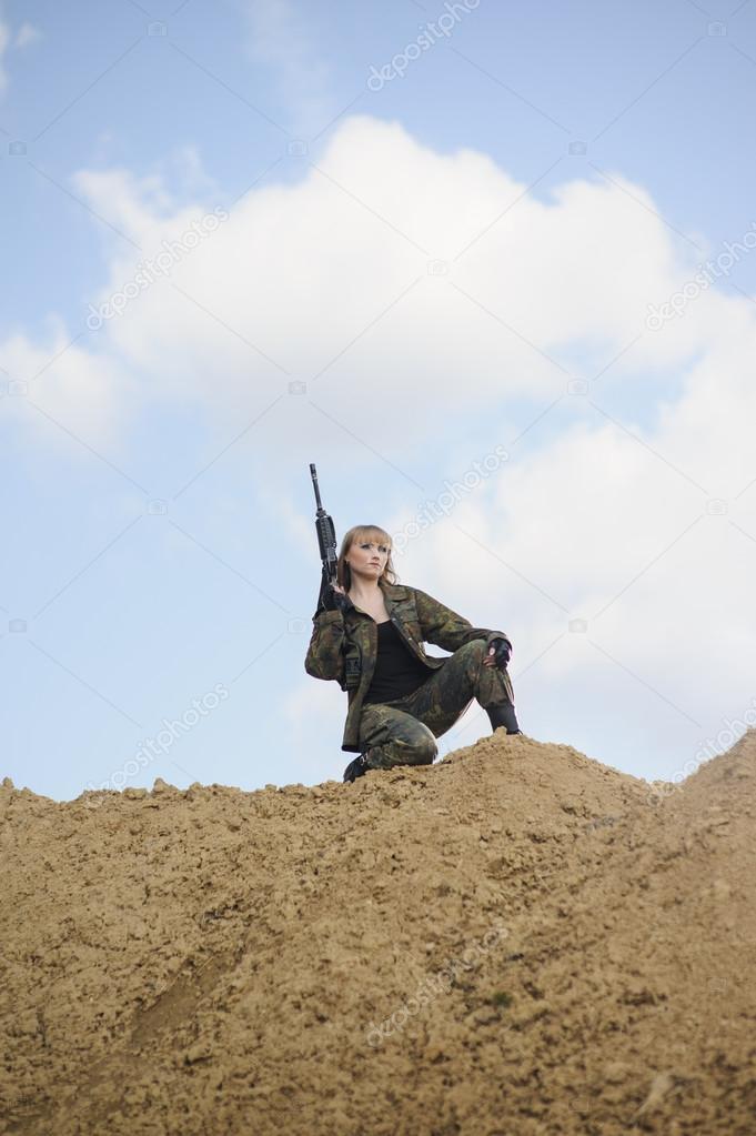 Beautiful army girl  with guns