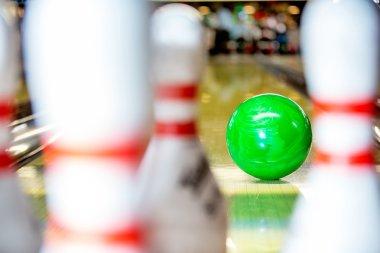 Bowling ball approaching pins