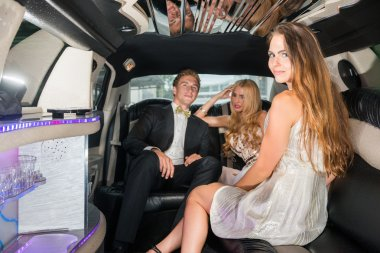 woman sitting with friends in limousine
