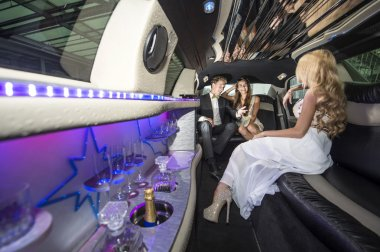 Celebrity and couple in a luxurious limousine