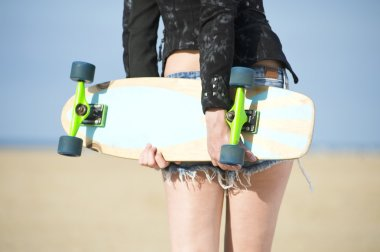 Woman holding Skateboard