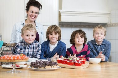 Mother and kids with desserts