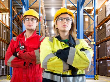 Two warehouse logistics employees