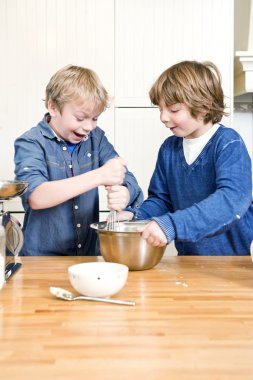 Kids having fun during a baking workshop