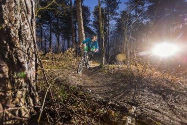 Mountainbiker through an off road trail