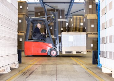 Worker Carrying Goods On Forklift