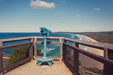 Binoculars overlooking ocean