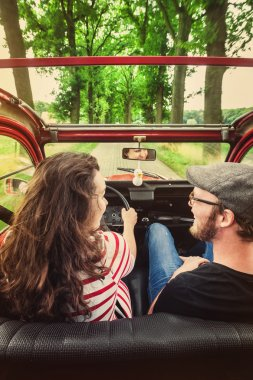 couple driving oldtimer